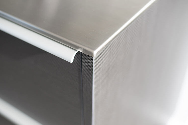 12mm Brushed Stainless steel benchtop. All kitchen cabinet exteriors in Laminam. Colour Filo Pece.