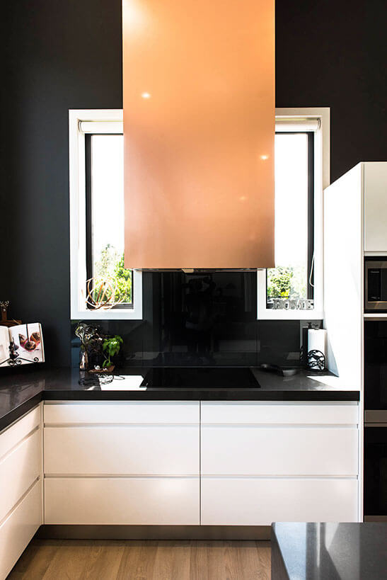 Integrated rangehood unit in copper laminate.