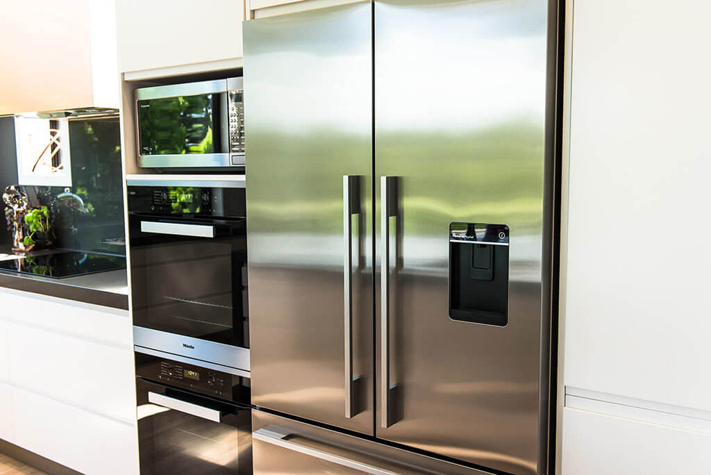 Fisher & Paykel fridge freezer with matching stainless trim kit